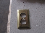 Bright brass duplex outlet covers