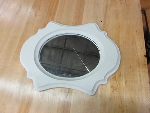 Small Wood framed oval  mirror